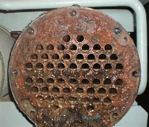 Heat exchanger flange face and tube sheet suffering from galvanic corrosion