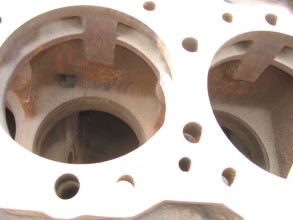 Cavitation and corrosion damage on engine block